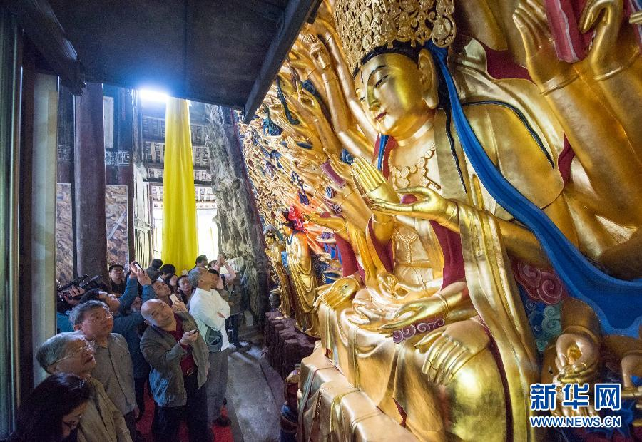 The restoration of a famous ancient Buddhist stone-carving statue in Chongqing has come to an end. The project lasted eight years and costs fifty million yuan.