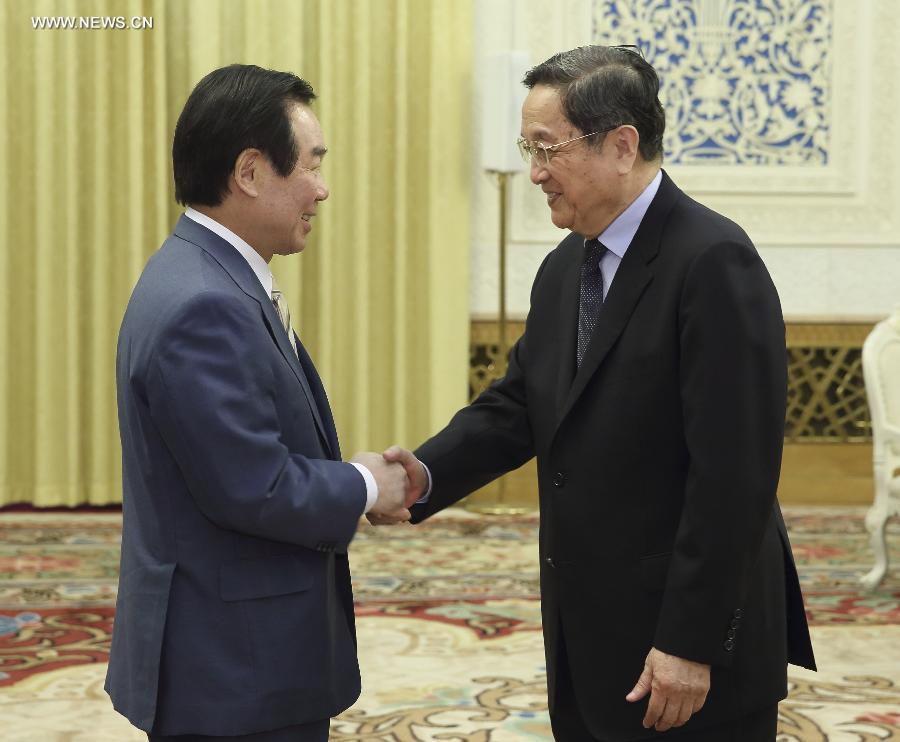كبير المستشارين السياسيين الصينيين يجتمع مع وفد يابانى