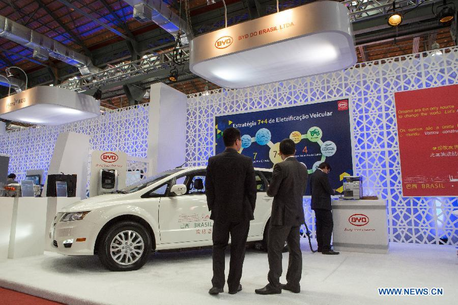 Visitors look at a car manufactured by China