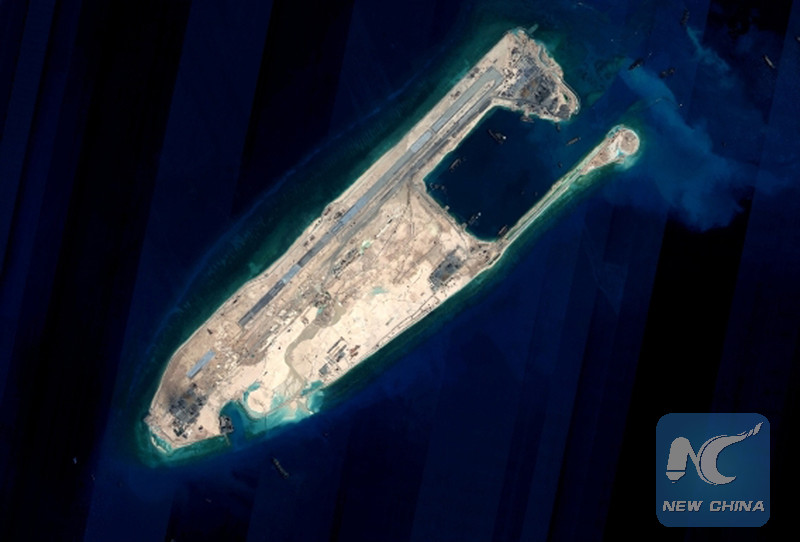 Satellite image shows the Yongshu reef of the Nansha Islands after a land reclamation project in south China. (Xinhua)