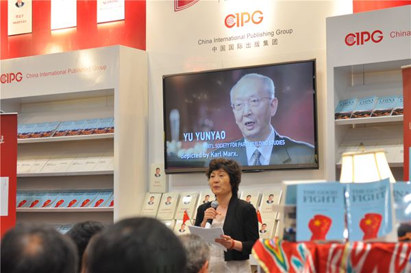Chinese Consul-general to New York Zhang Qiyue addresses the launch ceremony at the booth of the China International Publishing Group at BookExpo America on May 28, 2015. [Photo by Yan Pei/China.org.cn]
