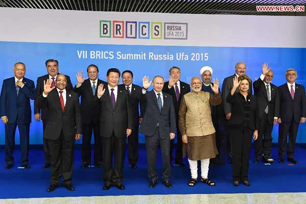 Chinese President Xi Jinping poses for photos with leaders of the Shanghai Cooperation Organization (SCO) members and observers, the Eurasian Economic Union (EEU) leaders, leaders of invited countries and the BRICS nations, namely Brazil, Russia, India, China and South Africa in Ufa, Russia, July 9, 2015. (Xinhua/Rao Aimin)