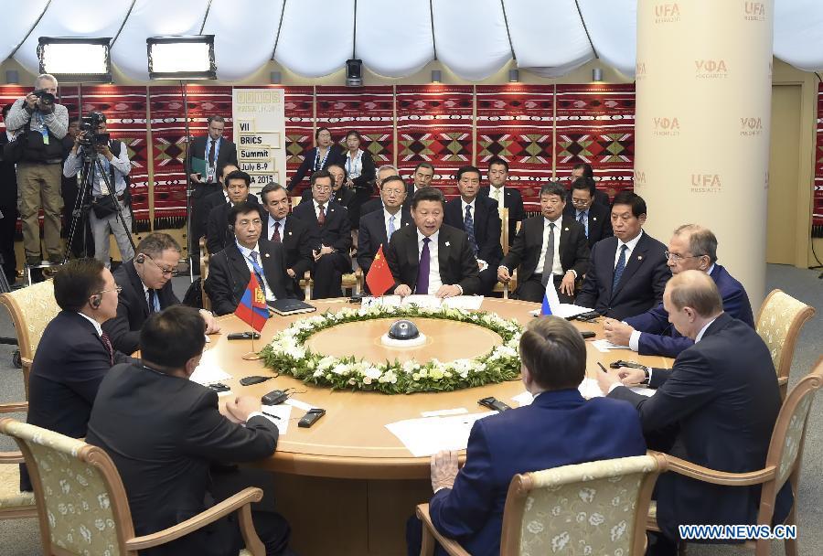 Chinese President Xi Jinping meets with Russian President Vladimir Putin and Mongolian President Tsakhiagiin Elbegdorj at the second trilateral meeting in Ufa, Russia, July 9, 2015. (Xinhua/Zhang Duo)