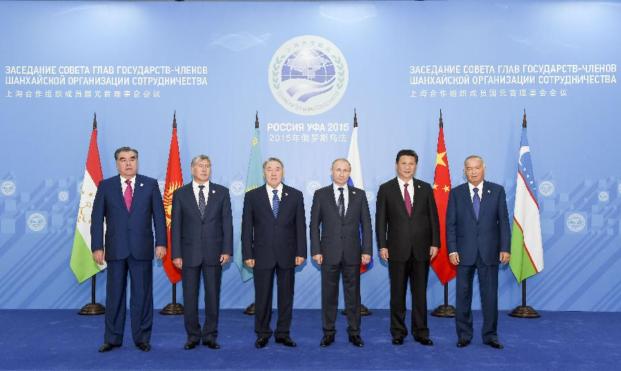 Chinese President Xi Jinping (2nd R) and other leaders of the Shanghai Cooperation Organization (SCO), Presidents of Tajikistan Emomali Rahmon (L), Kyrgyzstan Almazbek Atambayev (2nd L), Kazakhstan Nursultan Nazarbayev (3rd L), Russia Vladimir Putin (3rd R) and Uzbekistan Islam Karimov (R), pose for a group photo before the 15th SCO summit in Ufa, Russia, July 10, 2015. (Xinhua/Li Xueren)
