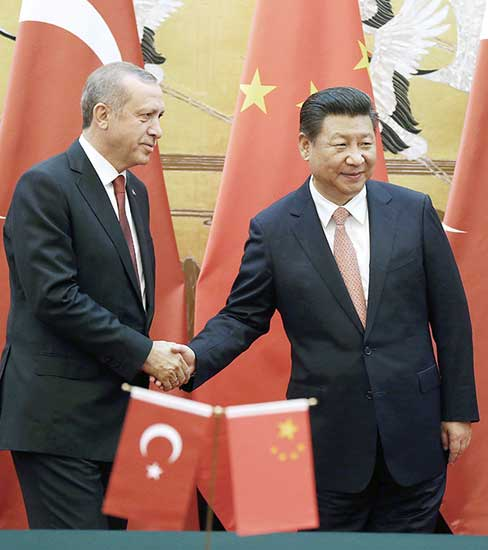 President Xi Jinping and his Turkish counterpart Recep Tayyip Erdogan appear at the Great Hall of the People on Wednesday after agreements were signed to improve bilateral cooperation.