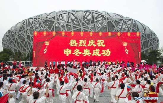 People gather to celebrate at the Olympic Green in Beijing, capital of China, July 31, 2015. Beijing, together with its neighbor city Zhangjiakou, won the bid to host the 2022 Olympic Winter Games. (Xinhua/Xie Huanchi)