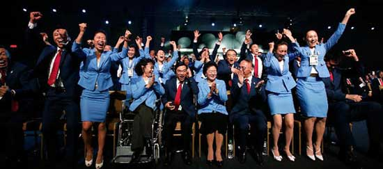 Members of Beijing 2022 Olympic Winter Games bid delegation celebrate after Beijing won the bid at the 128th International Olympic Committee session in Kuala Lumpur, Malaysia, Friday, July 31, 2015. (Xinhua/Wang Lili)
