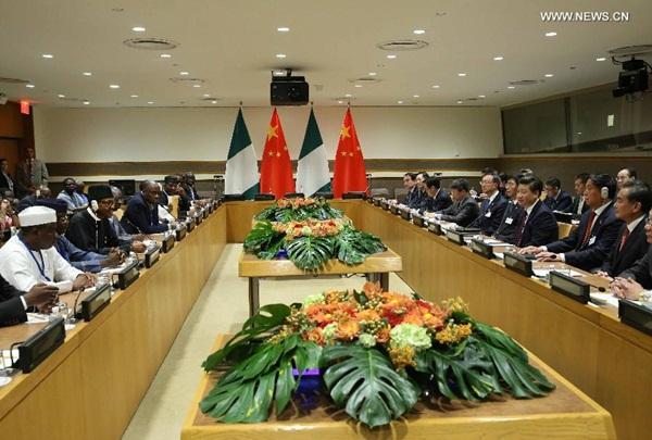 اجتمع الرئيس الصيني شي جين بينغ مع نظيره النيجيري محمد بخاري