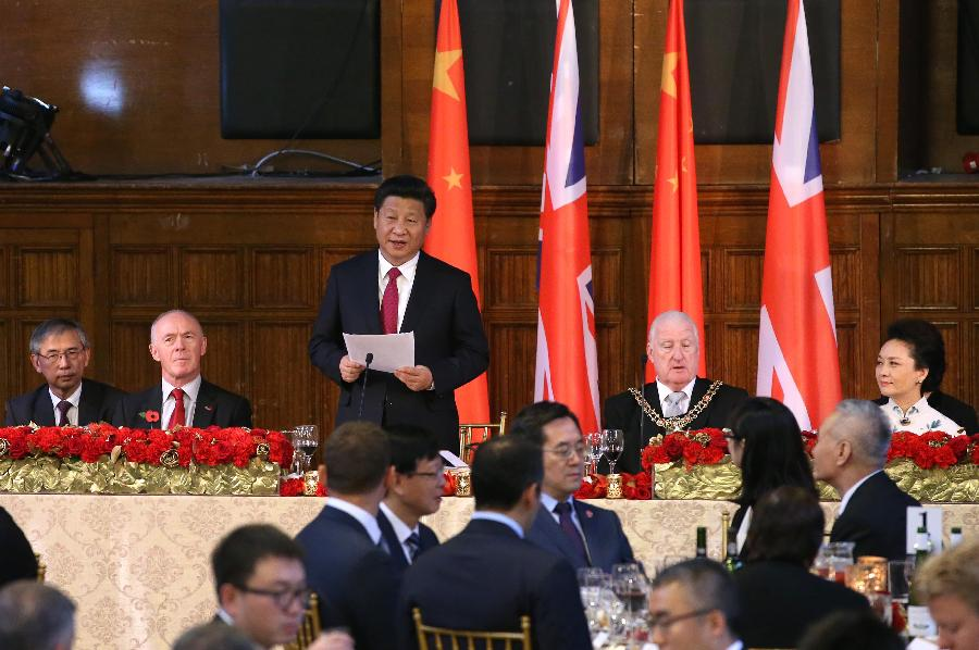Chinese President Xi Jinping (3rd L, back) addresses a welcome lunch held by the government of Manchester, in Manchester, Britain, Oct. 23, 2015. (Xinhua/Pang Xinglei)