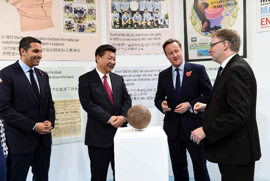 Chinese President Xi Jinping (2nd L), accompanied by British Prime Minister David Cameron (2nd R), visits the City Football Academy in Manchester, Britain, Oct. 23, 2015. (Xinhua/Rao Aimin)