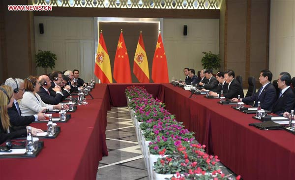 Chinese President Xi Jinping (3rd R) meets with Spain