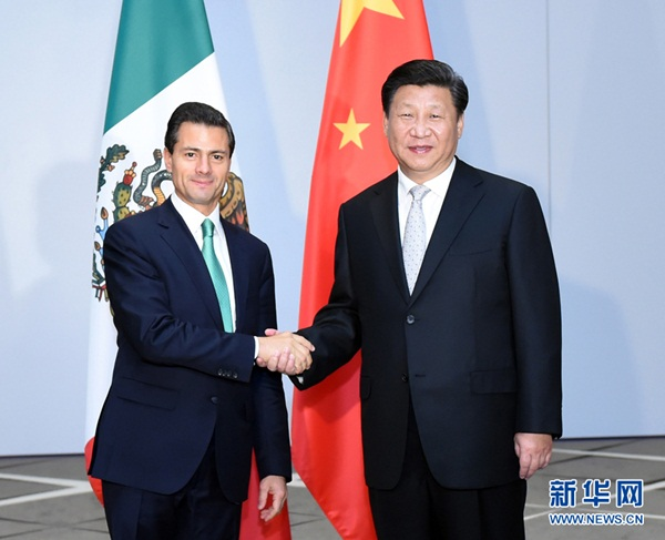 شي جين بينغ يلتقي الرئيس المكسيكي إنريكه بينيا نييتو