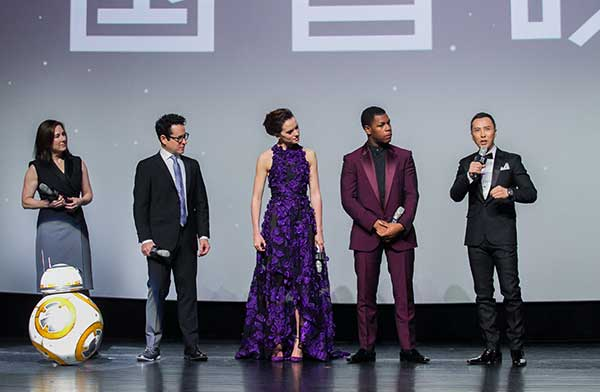 Chinese actor Donnie Yen (far right) with cast and crew members (from left to right) producer Kathleen Kennedy, director J.J. Abrams, actress Daisy Ridley and actor John Boyega at a promotional event in Shanghai for Star Wars