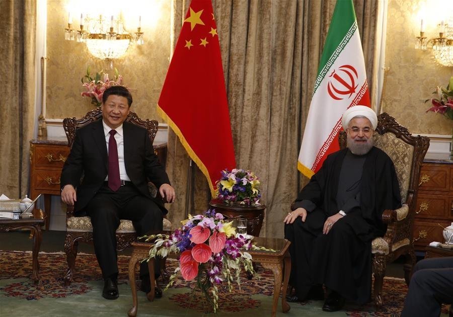 الرئيس الصيني شي جين بينغ يلتقي نظيره الإيراني حسن روحاني