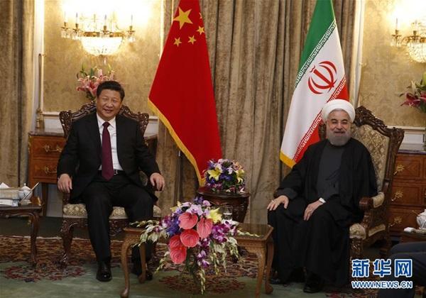 عقد الرئيس الصيني شي جين بينغ محادثات القمة مع نظيره الايراني حسن روحاني