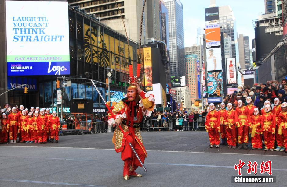 A flash mob featuring a hundred performers in monkey costumes, made an appearance for the Year of the Monkey at the Times Square in Manhattan, on the New Year