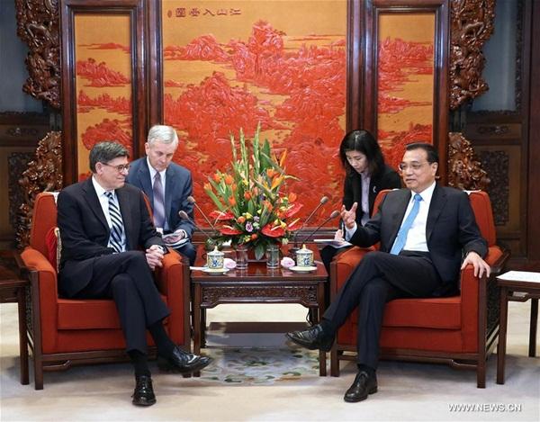 رئيس مجلس الدولة لي كه تشيانغ يلتقي وزير الخزانة الامريكي جاكوب ليو في بكين