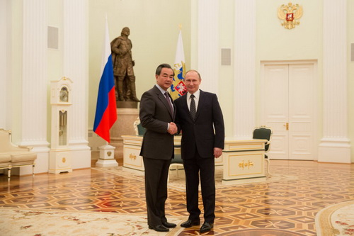 Russian President Vladimir Putin meets with Chinese Foreign Minister Wang Yi in Kremlin, Moscow, on Friday, March 11, 2016.