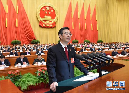 3月13日,十二届全国人大四次会议举行第三次全体会议。最高人民法院院长周强作工作报告。 新华社记者饶爱民摄