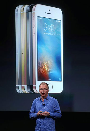 Apple VP Greg Joswiak announces the new iPhone SE during an Apple special event at the Apple headquarters in Cupertino, California, on March 21, 2016.
