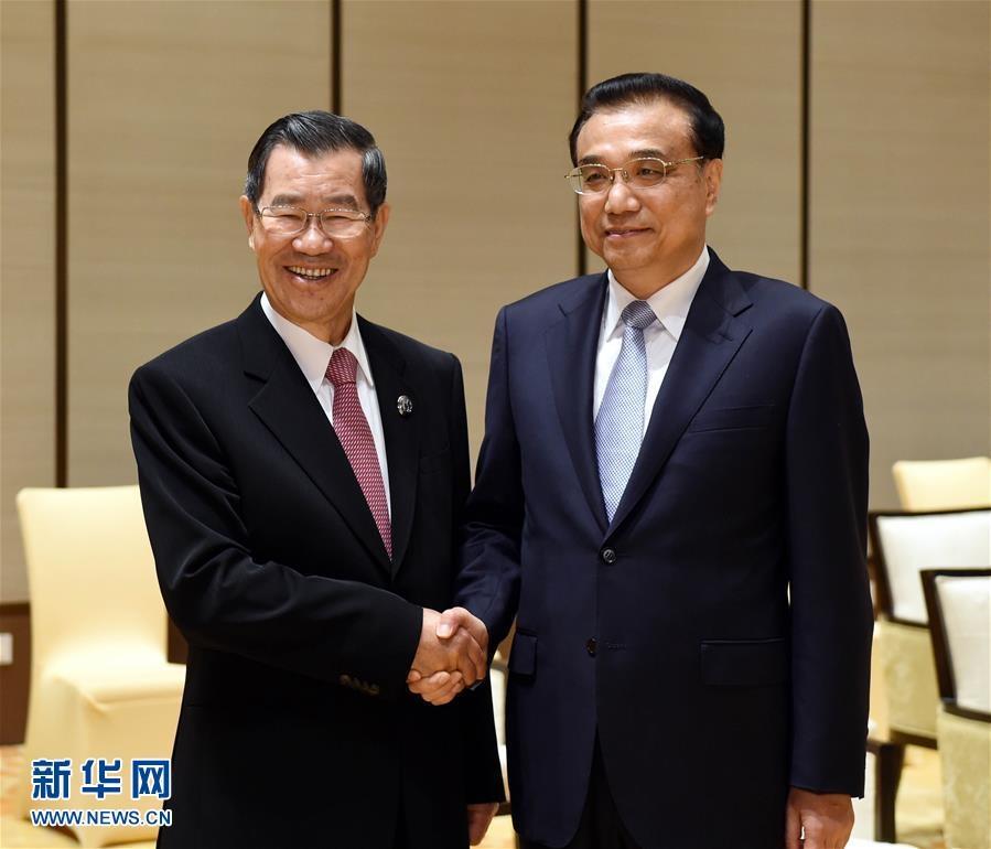لي كه تشيانغ يلتقي مع الرئيس الفخري لصندوق السوق المشتركة على جانبي المضيق بتايوان