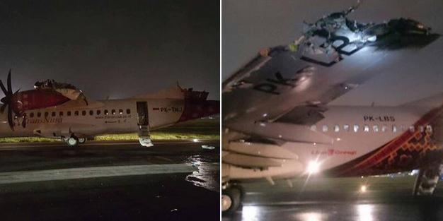印尼两客机跑道相撞 一客机尾翼被削掉(组图)