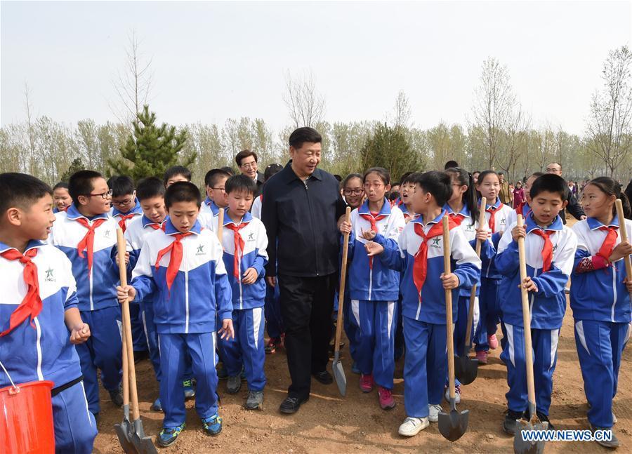 Chinese President Xi Jinping (C) walks with pupils after a tree-planting event in Xihongmen Township of Daxing District in Beijing, capital of China, April 5, 2016. Top leaders Xi Jinping, Li Keqiang, Zhang Dejiang, Yu Zhengsheng, Liu Yunshan, Wang Qishan and Zhang Gaoli attended a voluntary tree-planting in Beijing on Tuesday. (Xinhua/Li Xueren)
