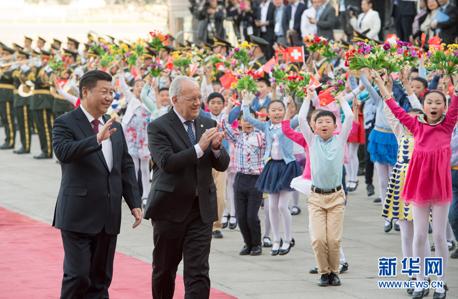 Chinese President Xi Jinping has met with his Swiss counterpart Johann Schneider-Ammann at the Great Hall of the People in Beijing.