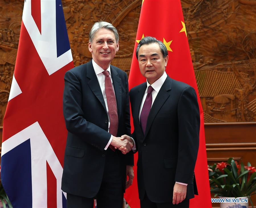 BEIJING, April 9, 2016 (Xinhua) -- Chinese Foreign Minister Wang Yi (R) meets with visiting British Foreign Secretary Philip Hammond in Beijing, capital of China, April 9, 2016. (Xinhua/Pang Xinglei)
