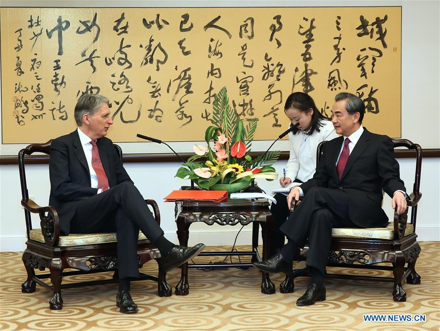 BEIJING, April 9, 2016 (Xinhua) -- Chinese Foreign Minister Wang Yi (1st R) meets with visiting British Foreign Secretary Philip Hammond in Beijing, capital of China, April 9, 2016. (Xinhua/Pang Xinglei)