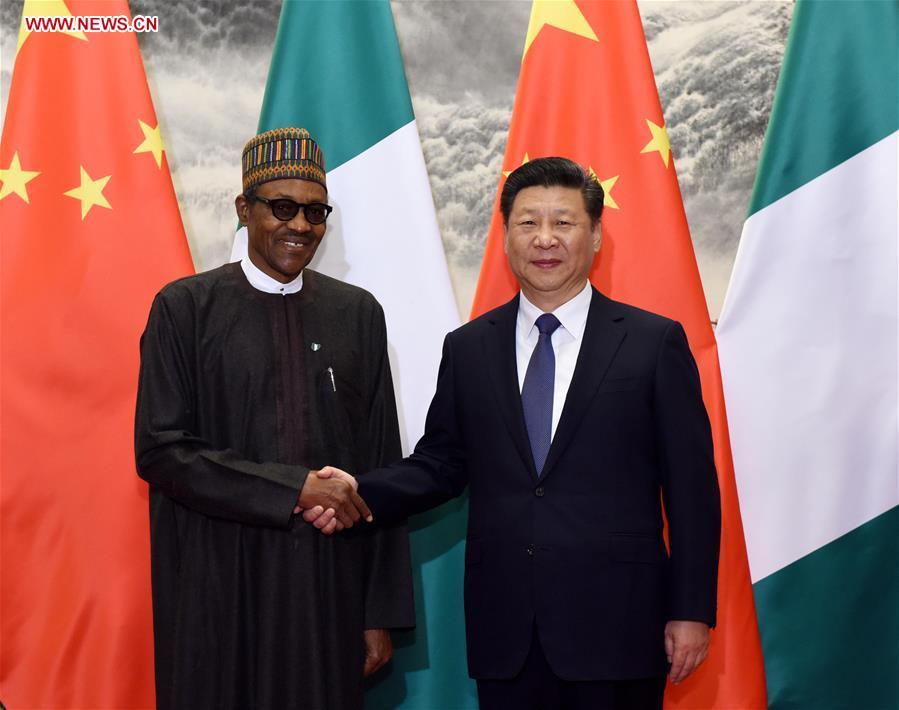 Chinese President Xi Jinping (R) holds talks with Nigerian President Muhammadu Buhari in Beijing, capital of China, April 12, 2016. (Xinhua/Rao Aimin)