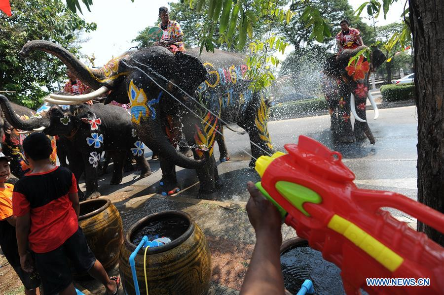 A man sprays water on an elephant with a toy gun during the celebration of the upcoming Songkran festival in Ayutthaya province, Thailand, April 11, 2016. Songkran, also known as the water festival, is celebrated in Thailand as the traditional New Year