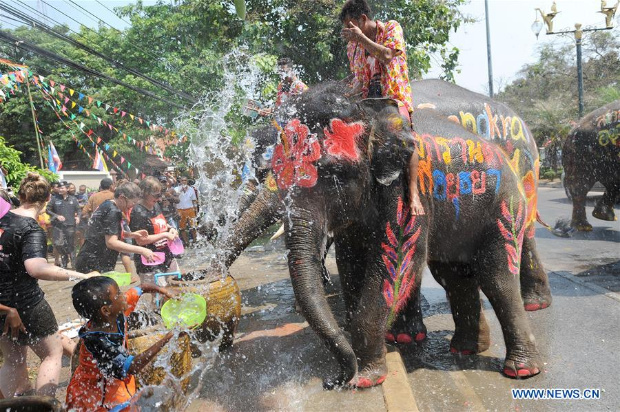Children splash water on elephants during the celebration of the upcoming Songkran festival in Ayutthaya province, Thailand, April 11, 2016. Songkran, also known as the water festival, is celebrated in Thailand as the traditional New Year