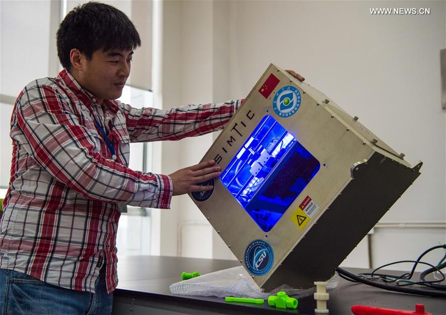 A micro-g 3D printer works in a tilting status at a research center in southwest China