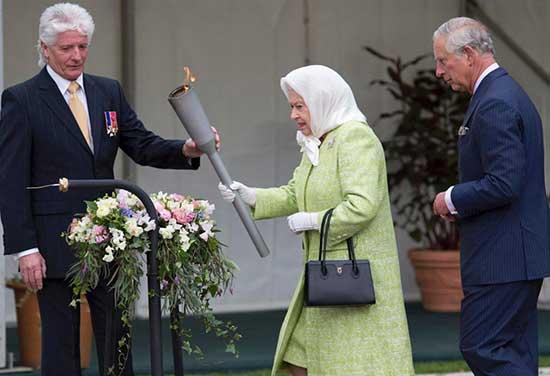 Pageantmaster Bruno Peek (L) hands Britain