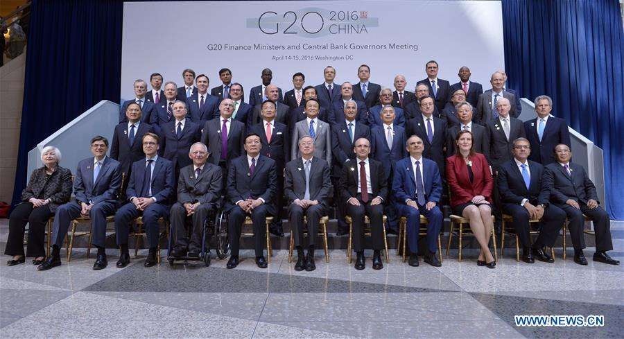 WASHINGTON D.C., April 15, 2016 (Xinhua) -- Finance ministers and central bankers of the G20 pose for a family photo after G20 meeting during the IMF and World Bank spring meetings in Washington D.C., capital of the United States, April 15, 2016.(Xinhua file photo/Yin Bogu)