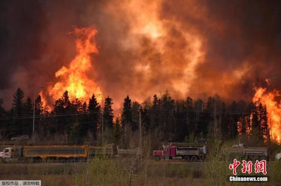 Canadian Authorities Say The Wildfire In Western Province Of Alberta Is Expected To Double