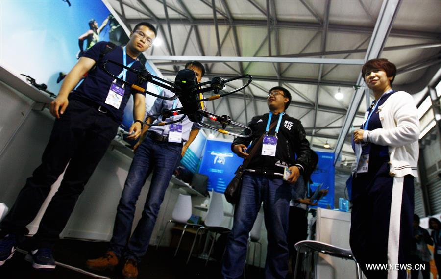 SHANGHAI, May 11, 2016 (Xinhua) -- A drone flies for demonstration during CES Asia 2016 in Shanghai, east China, May 11, 2016. The CES Asia 2016, with the participation of over 3,200 enterprises from over 150 countries, kicked off here Wednesday. (Xinhua/Fang Zhe)