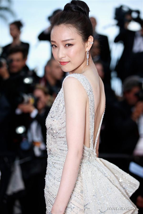 CANNES, May 11, 2011 (Xinhua) -- Chinese actress Ni Ni poses on the red carpet before the opening of the 69th Cannes Film Festival in Cannes, France, on May 11, 2016. The 69th Cannes Film Festival will be held from May 11 to 22. (Xinhua/Jin Yu)