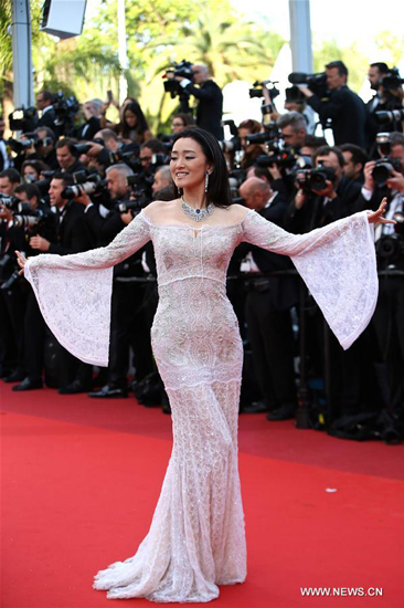 Gong Li on red carpet in Cannes