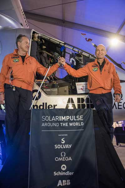 The file photo shows the two pilots of the Swiss-made Solar Impulse 2 in front of the airplane.
