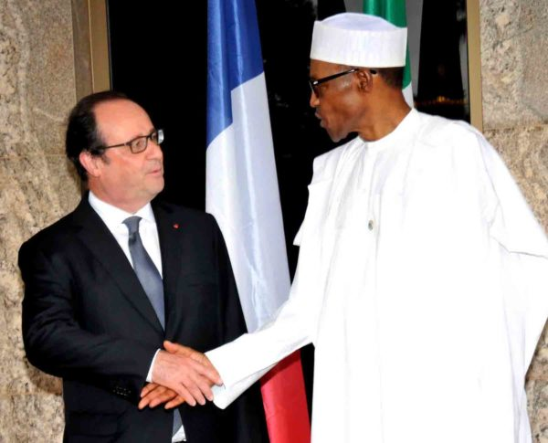 President Muhammadu Buhari(R) welcoming the visiting French President, Francois Hollande at the presidential villa Abuja on Saturday.
