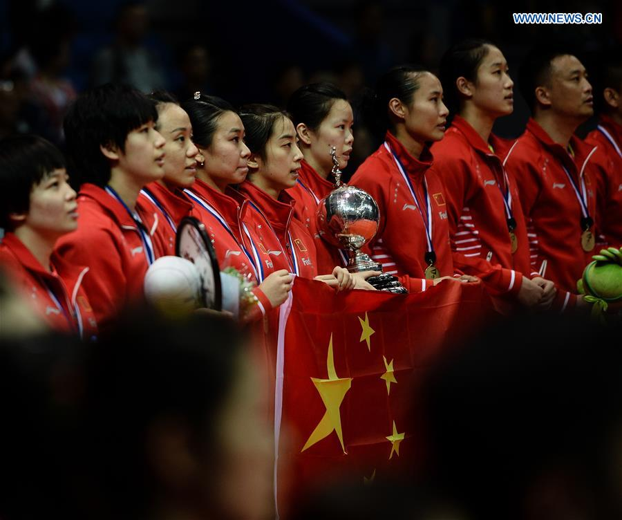 KUNSHAN, May 21, 2016 (Xinhua) -- Team China celebrates on the podium during the award ceremony after winning the title at the Uber Cup badminton championship in Kunshan, east China