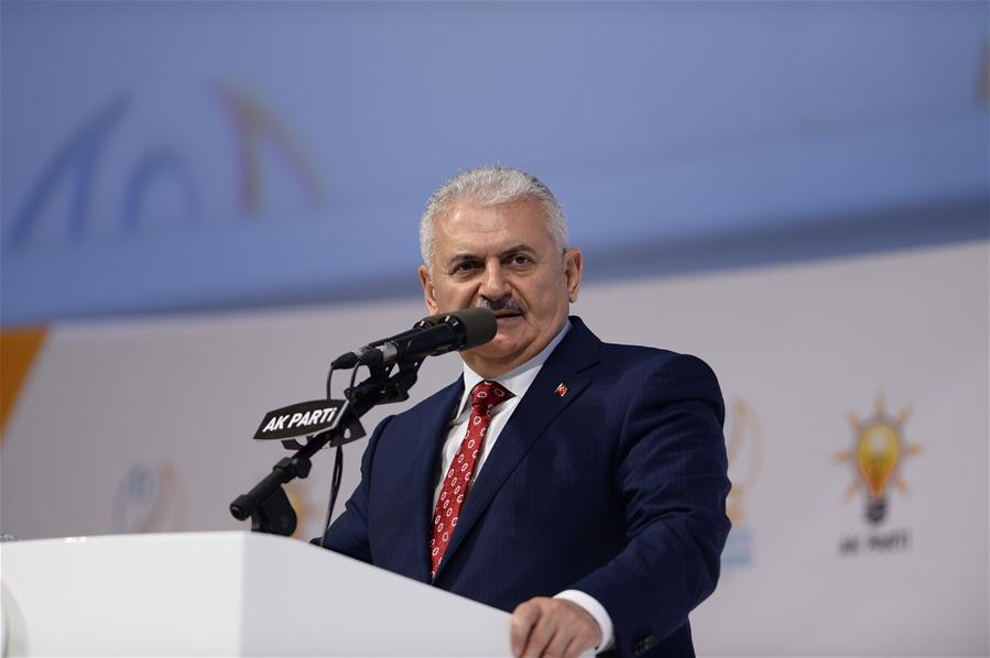 Binali Yildirim addresses his supporters at the congress of Turkish ruling Justice and Development Party in Ankara, Turkey on May 22, 2016.  (Xinhua/Mustafa Kaya)