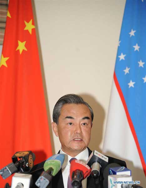 TASHKENT, May 24, 2016 (Xinhua) -- Chinese Foreign Minister Wang Yi addresses reporters after attending a meeting of the Shanghai Cooperation Organization (SCO) foreign ministers in the capital of Uzbekistan on May 24, 2016. The Shanghai Cooperation Organization (SCO) has become a paradigm of global and regional cooperation with great vitality and significant influence since its founding 15 years ago, visiting Chinese Foreign Minister Wang Yi said here Tuesday. (Xinhua/Sadat)