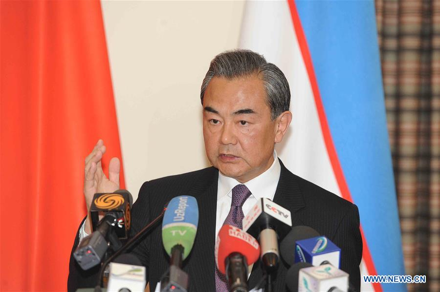 Chinese Foreign Minister Wang Yi addresses reporters after attending a meeting of the Shanghai Cooperation Organization (SCO) foreign ministers in the capital of Uzbekistan on May 24, 2016. The Shanghai Cooperation Organization (SCO) has become a paradigm of global and regional cooperation with great vitality and significant influence since its founding 15 years ago, visiting Chinese Foreign Minister Wang Yi said here Tuesday. (Xinhua/Sadat)