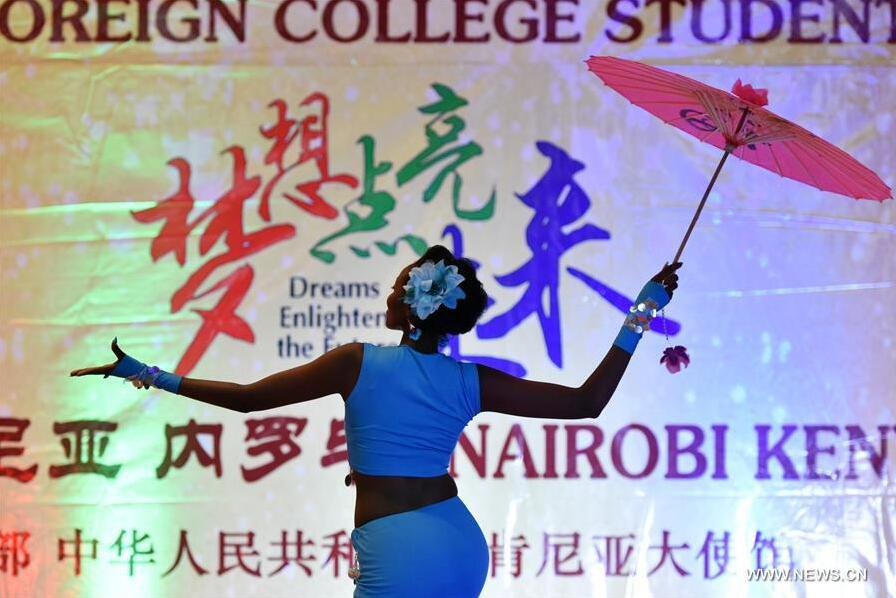"""Ruth Wakuhi Kimani from Confucius Institute of Nairobi University performs a Chinese dance during the 15th Chinese Bridge Chinese Proficiency Competition for Foreign College Students Kenya Division in Nairobi, Kenya, May 23, 2016. With the theme """"Dreams Enlighten the Future"""", the 15th Chinese Bridge Chinese Proficiency Competition for Foreign College Students Kenya Division was held in Nairobi. Ruth Wakuhi Kimani from Confucius Institute of Nairobi University won the contest and earned herself the ticket to the world final in China. [Photo: Xinhua/Sun Ruibo]"""
