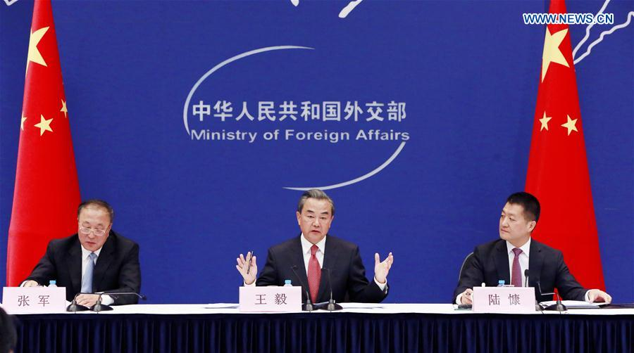 Chinese Foreign Minister Wang Yi (C) speaks at a press briefing on preparations for the Hangzhou G20 summit in Beijing, capital of China, May 26, 2016. (Xinhua/Pan Xu)