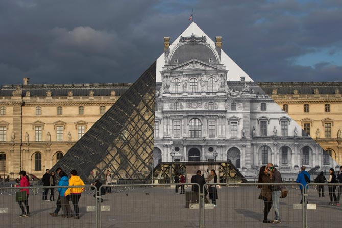 The 33-year-old artist was invited by the famed art museum, Musee Du Louvre, to create a monumental optical illusion.