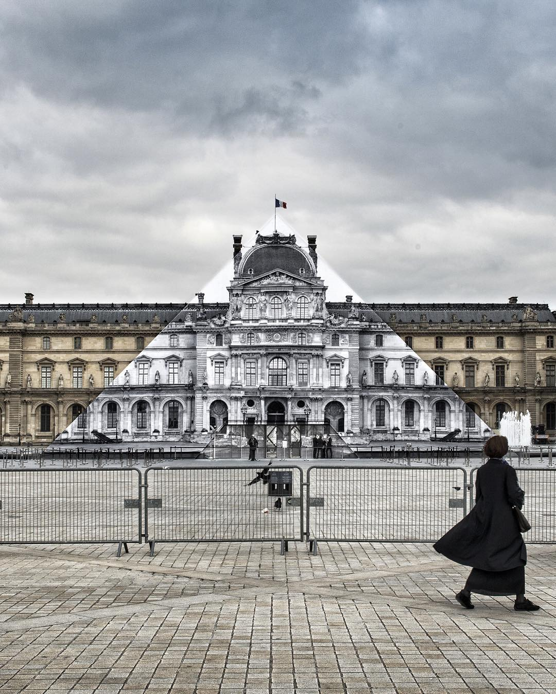 Artist JR hides the Louvre Pyramid